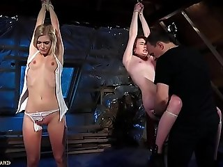 BDSM Punishing two teen slaves using leather whip